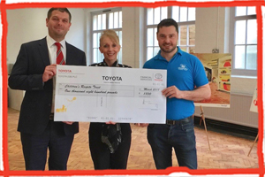 The Children's Respite Trust in East Sussex is given a cheque for £1,800 by Uckfield's SLM Toyota