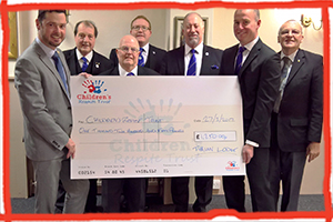 Freemasons from Tyrian Lodge at Eastbourne's Masonic Hall presented a charity donation for £1,250 to the Children's Respite Trust to help children in Sussex